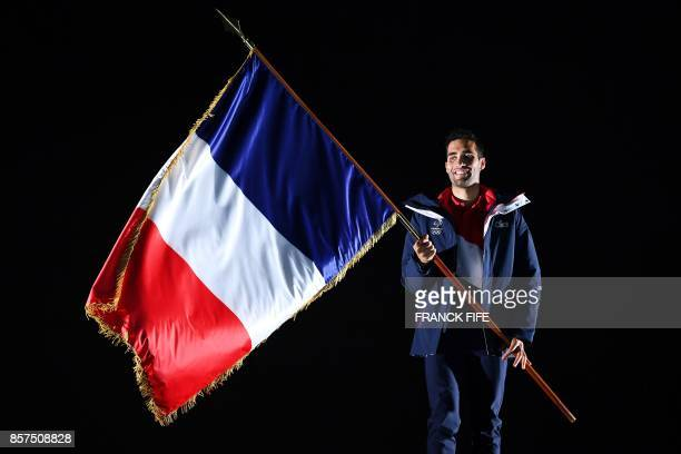 Martin Fourcade, two-time Olympic biathlon champion and flag-bearer of the French team at the Pyeongchang Winter Games in February 2018, poses with...