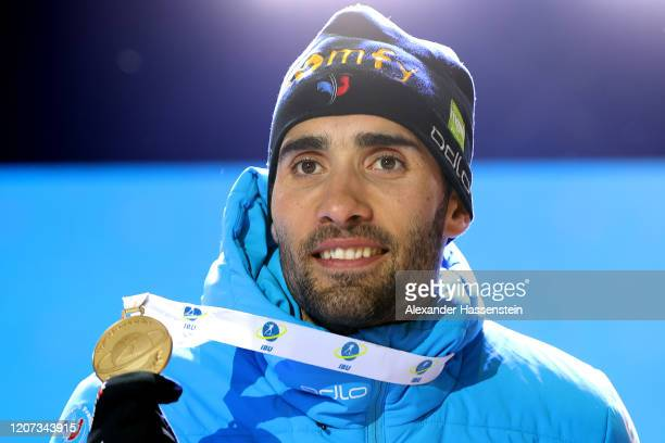 Martin Fourcae of France celebrates winning the Gold medal at the medal ceremony for the Men 20 km Individual Competition at the IBU World...