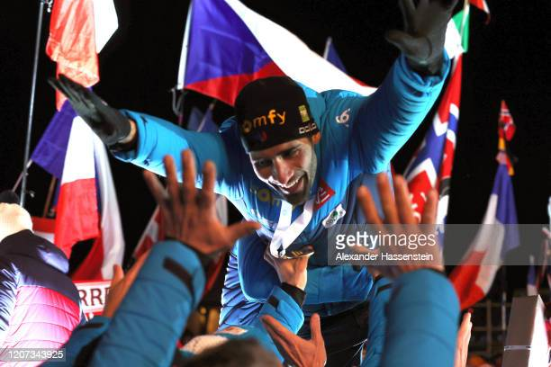Martin Fourcae of France celebrates with his team mates winning the Gold medal at the medal ceremony for the Men 20 km Individual Competition at the...