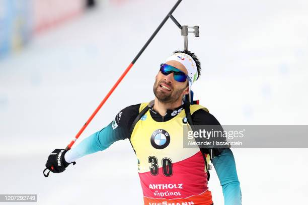 Martin Fourcae of France reacts after crossing the finish line of during the Men 20 km Individual Competition at the IBU World Championships Biathlon...