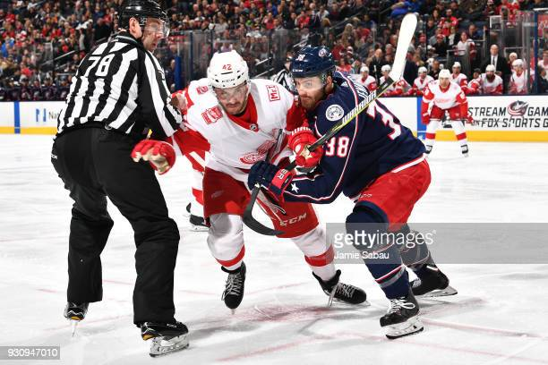 Martin Frk of the Detroit Red Wings and Boone Jenner of the Columbus Blue Jackets battle for position off the face off on March 9 2018 at Nationwide...