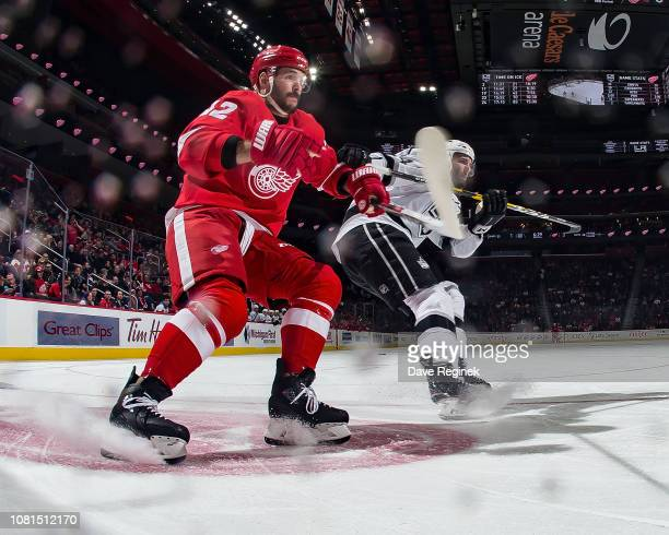 Martin Frk of the Detroit Red Wings battles for the puck with Derek Forbort of the Los Angeles Kings during an NHL game at Little Caesars Arena on...