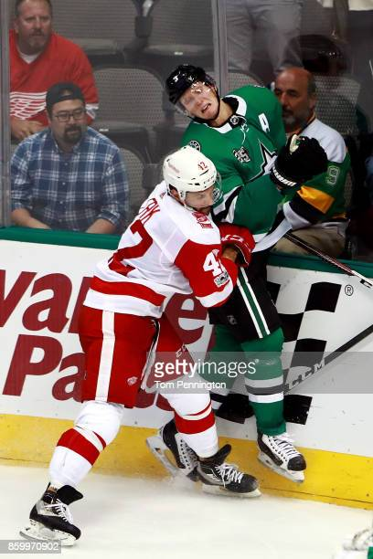 Martin Frk of the Detroit Red Wings checks John Klingberg of the Dallas Stars into the glass in the third period at American Airlines Center on...