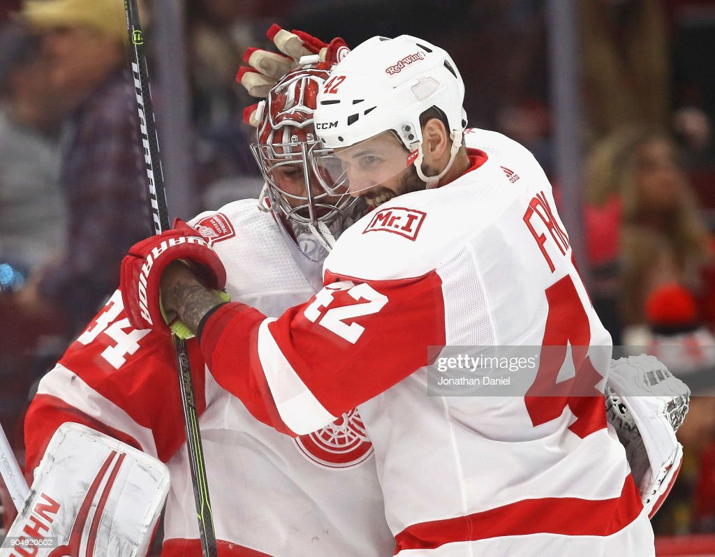 Martin Frk #42 of the Detroit Red Wings hugs Petr Mrazek #34 after shoutout win against the Chicago Blackhawks at the United Center on January 14, 2018 in Chicago, Illinois. The Red Wings defeated the Blackhawks 4-0.