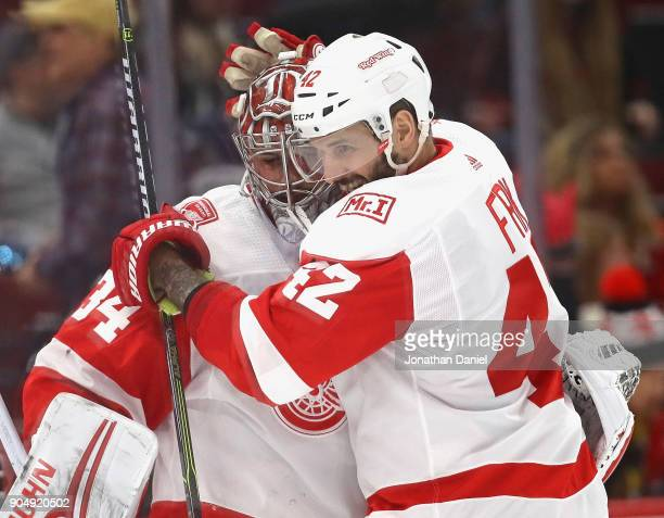 Martin Frk of the Detroit Red Wings hugs Petr Mrazek after shoutout win against the Chicago Blackhawks at the United Center on January 14 2018 in...