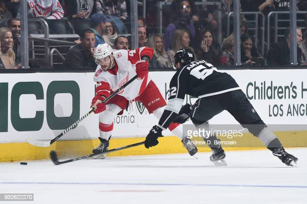 Martin Frk of the Detroit Red Wings passes the puck against Michael Amadio of the Los Angeles Kings at STAPLES Center on March 15 2018 in Los Angeles...
