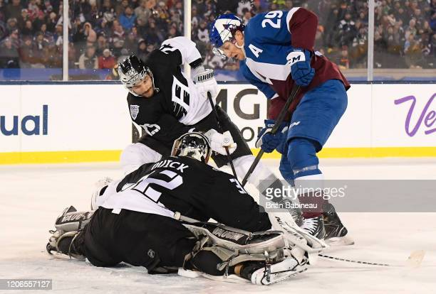 Martin Frk of the Los Angeles Kings and Nathan MacKinnon of the Colorado Avalanche dig for the loose puck in front of goaltender Jonathan Quick of...