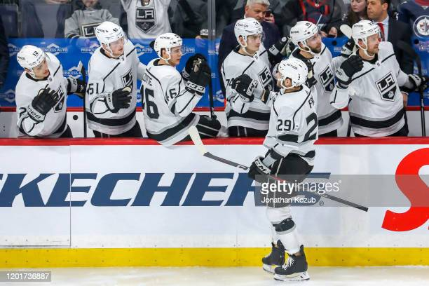 Martin Frk of the Los Angeles Kings celebrates his third period goal against the Winnipeg Jets with teammates at the bench at the Bell MTS Place on...