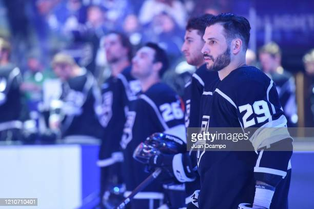 Martin Frk of the Los Angeles Kings looks on during during the National Anthem prior to the game against the Toronto Maple Leafs at STAPLES Center on...