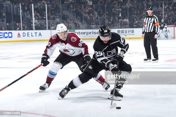 Martin Frk of the Los Angeles Kings skates with the puck with pressure from Vladislav Namestnikov of the Colorado Avalanche during the third period...