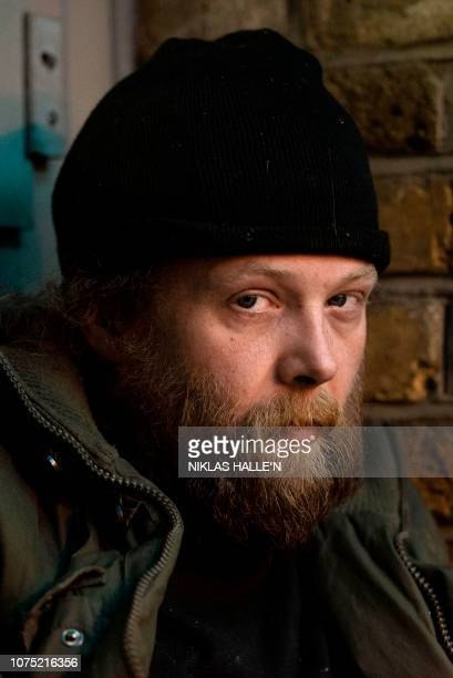 Martin from Berlin Germany homeless after previously working in the logistics business poses for a photograph near to Charing Cross station in...
