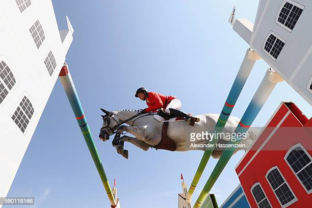 Martin Fuchs of Switzerland rides Clooney during the Team Jumping on Day 11 of the Rio 2016 Olympic Games at the Olympic Equestrian Centre on August...