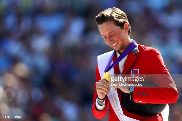 Martin Fuchs of Switzerland riding Clooney 51 celebrates winning the gold medal on Day 7 in the Individual Final, Longines FEI Jumping European...