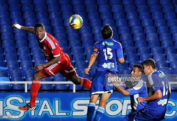 Martin Garcia of America heads the ball during a match between America de Cali and Rionegro as part of 12th round of Torneo Postobon 2014 II at...