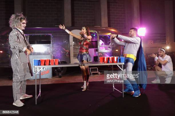 Martin Garrix Andrea Zara and Alex Mansuroglu play beer pong backstage at the Kiss Haunted House Party held at SSE Arena on October 26 2017 in London...