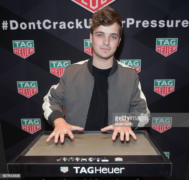 Martin Garrix makes a handprint mold at the Tag Heuer Boutique at The Forum Shops at Caesars on March 24 2018 in Las Vegas Nevada