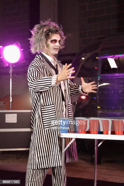 Martin Garrix plays beer pong backstage during the Kiss Haunted House Party held at SSE Arena on October 26 2017 in London England