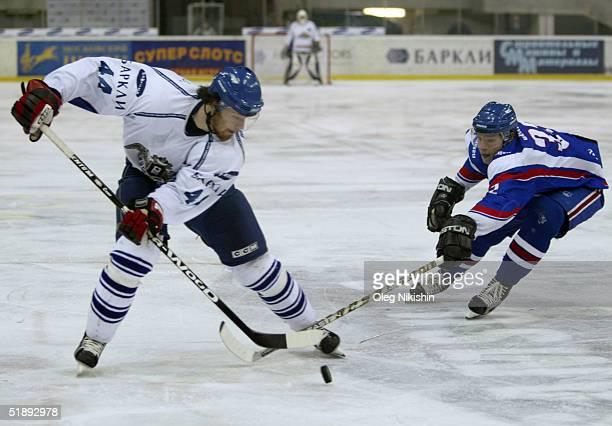 Martin Gavlat of Dynamo Moscow player and Alexander Semin of Lada Togliatti player skate during a game December 24 2004 at Luzhniki Ice Arena in...