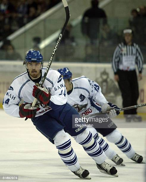 Martin Gavlat of Dynamo Moscow player and Lada Togliatti player skate during a game December 24 2004 at Luzhniki Ice Arena in Moscow Russia Lada...