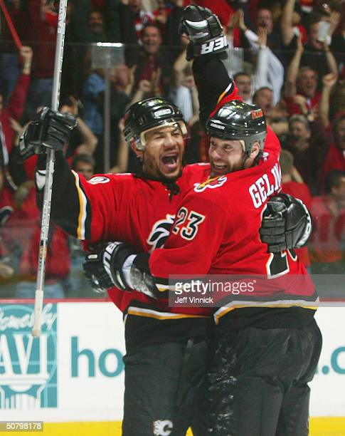 Martin Gelinas of the Calgary Flames celebrates his overtime winning goal with teammate Jarome Iginla during the first overtime period of game six of...