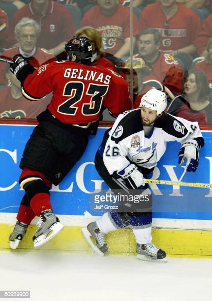 Martin Gelinas of the Calgary Flames misses the check on Martin St Louis of the Tampa Bay Lightning in game six of the NHL Stanley Cup Finals on June...