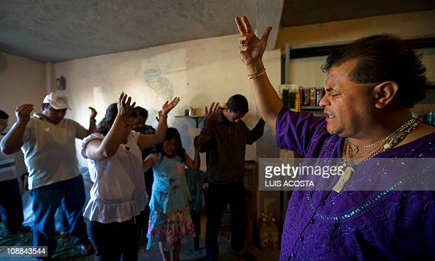 PINEDA Martin George priest of the Holy Death cult prays in a shrine in the Municipality of Chalco 40 km east of Mexico City on February 3 2011 The...