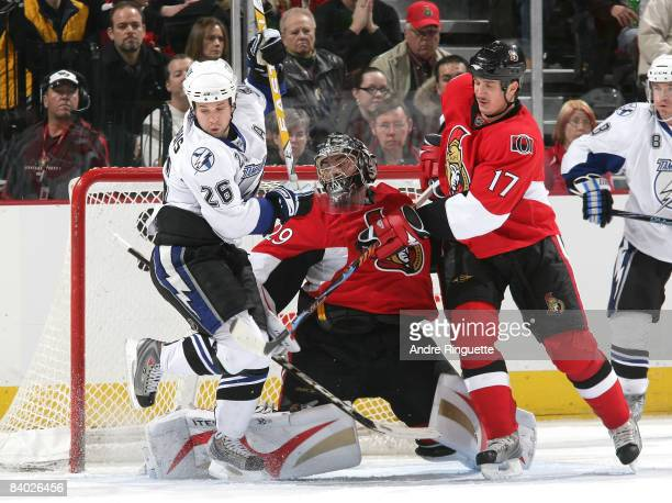 Martin Gerber and Filip Kuba of the Ottawa Senators defend against Martin St Louis of the Tampa Bay Lightning at Scotiabank Place on December 13 2008...