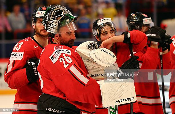 Martin Gerber, goaltender of Swiss looks dejected after losing the IIHF World Championship final match between Swiss and Sweden at Globen Arena on...