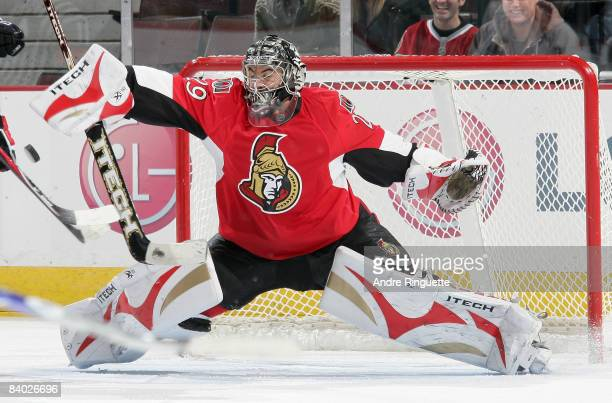 Martin Gerber of the Ottawa Senators makes a save on his way to a shutout against the Tampa Bay Lightning at Scotiabank Place on December 13 2008 in...