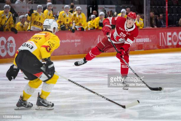 Martin Gernat of Lausanne HC shoots on goal in front of Dustin Jeffrey of SC Bern during the Swiss National League game between Lausanne HC and SC...