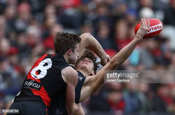 Martin Gleeson of the Bombers challenges Charlie Curnow of the Blues during the round 20 AFL match between the Essendon Bombers and the Carlton Blues...