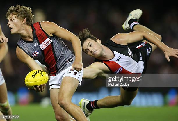 Martin Gleeson of the Bombers is tackled by Dylan Roberton of the Saints during the round five AFL match between the St Kilda Saints and the Essendon...