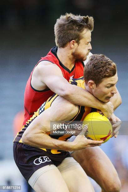 Martin Gleeson of the Bombers tackles Tim O'Brien of the Hawks during the AFLX match between Hawthorn Hawks and Eseendon Bombers at Etihad Stadium on...