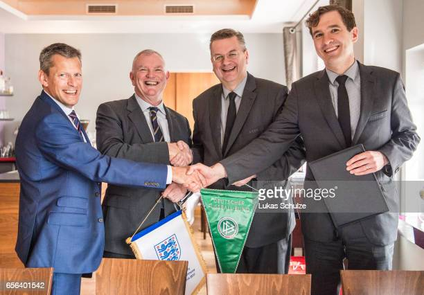 Martin Glenn FA Chairman Greg Clarke DFB president Reinhard Grindel and DFB general secretary Friedrich Curtius pose after signing a memorandum of...