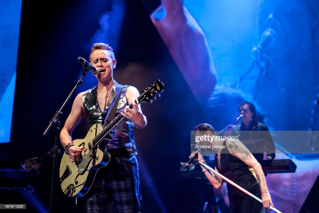 Martin Gore and Dave Gahan of Depeche Mode perform on stage at First Direct Arena on November 13, 2013 in Leeds, United Kingdom.