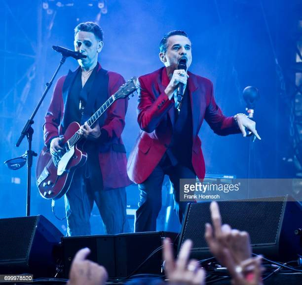 Martin Gore and Dave Gahan of the British band Depeche Mode perform live on stage during a concert at the Olympiastadion on June 22 2017 in Berlin...