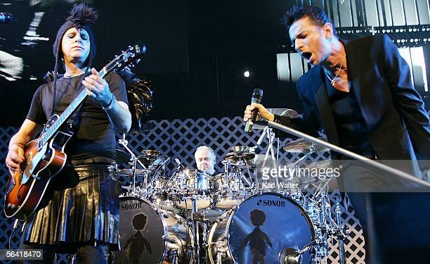 """Martin Gore, Christian Eigner, and Dave Gahan of Depeche Mode perform at night two of 106.7 KROQ's """"Almost Acoustic Christmas"""" at Gibson Ampitheatre..."""