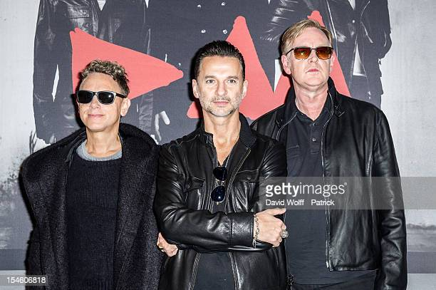Martin Gore Dave Gahan and Andrew Fletcher pose during a photocall at a press conference to announce the release of a new album and world tour in...