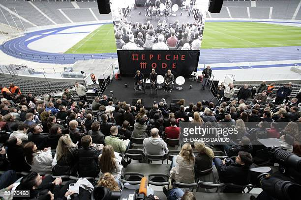 Martin Gore Dave Gahan and Andrew Fletcher talk to the press during a press conference at the Olympic stadium on October 6 2008 in Berlin Germany...