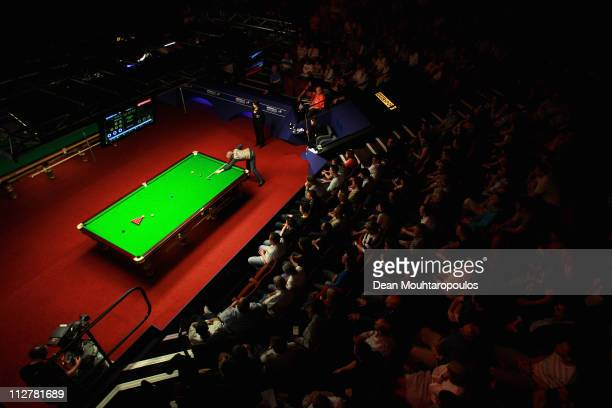 Martin Gould of England plays a shot in the round two game against Judd Trump of England on day six of the Betfred.com World Snooker Championship at...