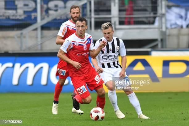 Martin Grasegger of FC Linz Mario Ebenhofer of FC Linz and Nicolas Meister of Juniors OOe during the 2 Liga match between FC Juniors OOe v FC Blau...