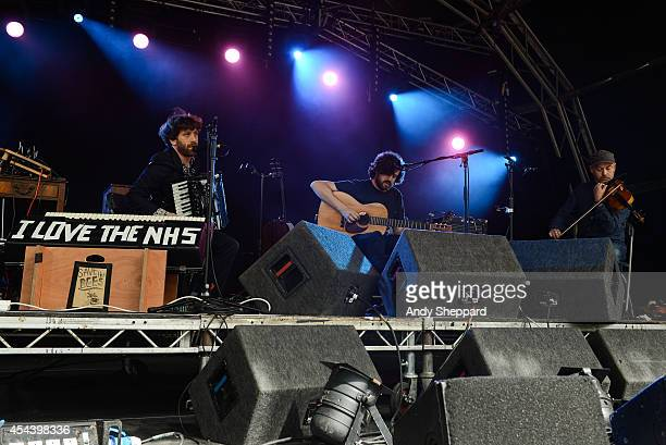 Martin Green Kris Drever and Aidan O'Rourke of the band Lau perform on stage at End Of The Road Festival 2014 at Larmer Tree Gardens on August 30...