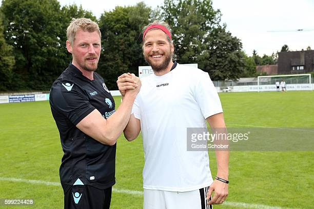 Martin Gruber and Sebastian Stroebel the former 'Bergretter' and the new one during the charity football game 'Kick for Kids' to benefit 'Die...