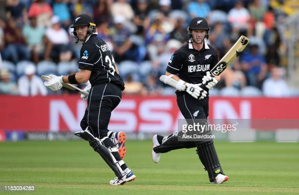 Martin Guptill and Colin Munro of New Zealand run during the Group Stage match of the ICC Cricket World Cup 2019 between New Zealand and Sri Lanka at...