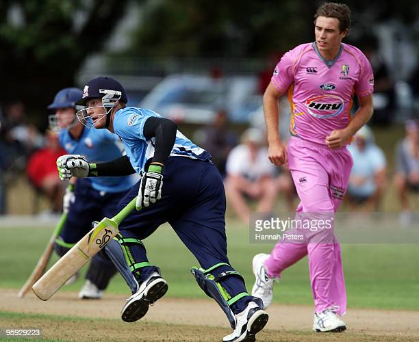 Martin Guptill and Scott Styris of Auckland run between the wickets as Tim Southee of Northern looks on during the HRV Cup Twenty20 match between the...