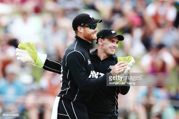 Martin Guptill and Tom Latham of New Zealand celebrate the wicket of Sarfraz Ahmed of Pakistan during game four of the One Day International Series...