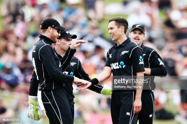Martin Guptill and Trent Boult of New Zealand celebrate the wicket of Sarfraz Ahmed of Pakistan during game four of the One Day International Series...