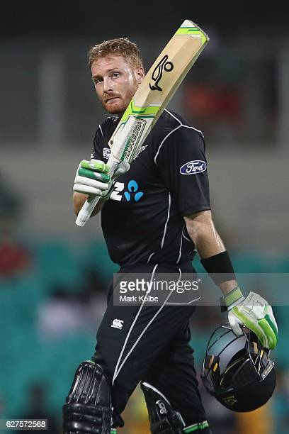 Martin Guptill of New Zealand acknowledges the crowd as he leaves the field after scoring 114 during game one of the One Day International series...