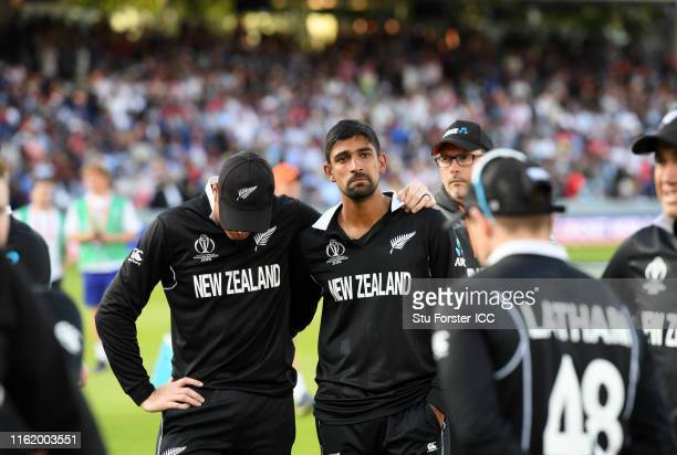 Martin Guptill of New Zealand and Ish Sodhi of New Zealand react after losing during the Final of the ICC Cricket World Cup 2019 between New Zealand...