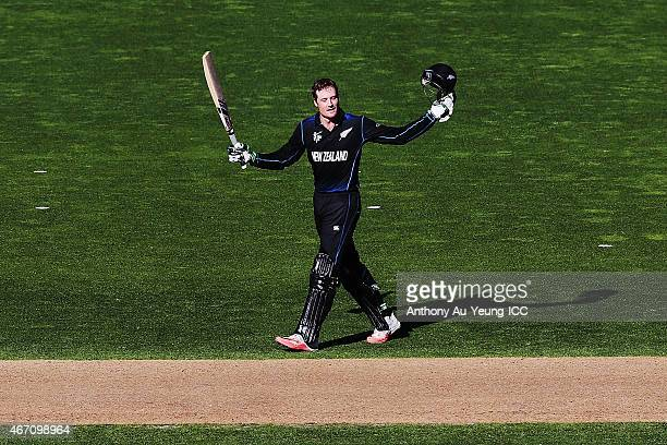Martin Guptill of New Zealand celebrates after scoring a century during the 2015 ICC Cricket World Cup match between New Zealand and the West Indies...